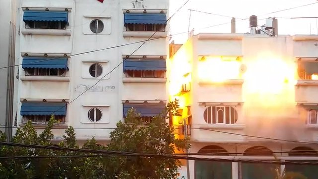 A still from footage shows the moment a Gaza house was destroyed by Israeli airstrike