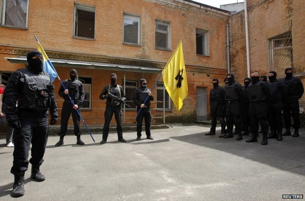 Azov Battalion fighters parading with flags in Kiev, 3 June