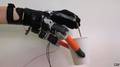 Robotic hand holding coffee cup