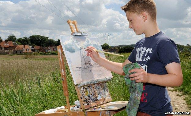 Kieron Williamson with painting