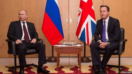 Prime Minister David Cameron sits with Russian President Vladimir Putin at a meeting at Charles De Gaulle Airport in Paris on 5 June 2014