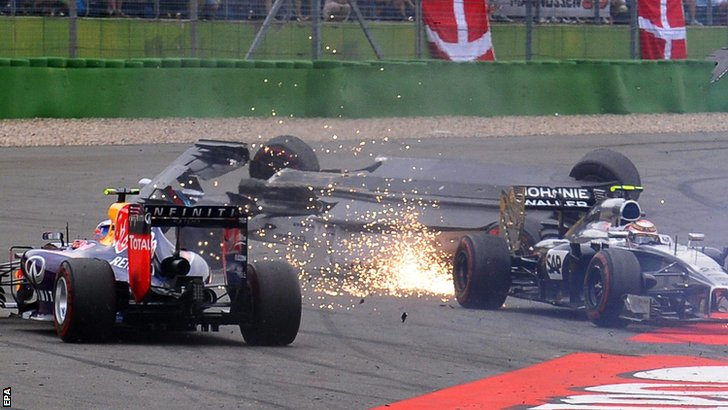 Felipe Massa (left) collides with Kevin Magnussen