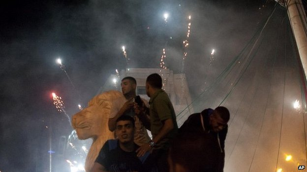 Palestinians launch fireworks during celebrations in the West bank city of Ramallah after Hamas said it had taken an Israeli soldier hostage - 20 July 2014
