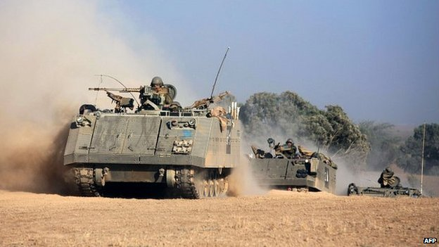 A convoy of Israeli armoured personnel carriers roll towards the Israeli-Gaza border - 20 July 2014