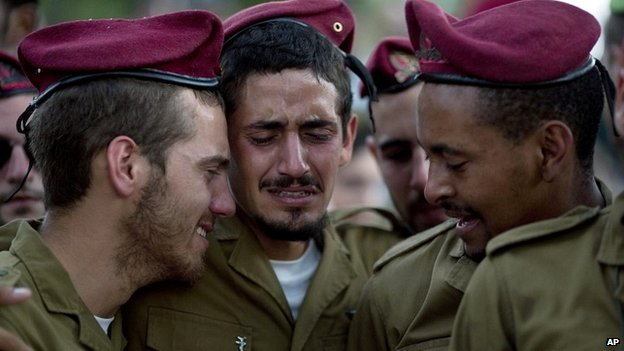 Israeli soldiers mourn during the funeral of Sgt. Bnaya Rubel at the military cemetery in Holon, Israel - 20 July 2014