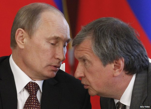Russian President Vladimir Putin (left) talks to Rosneft President Igor Sechin