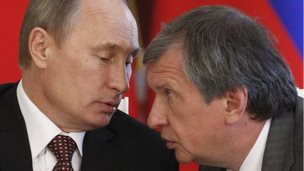 Russian President Vladimir Putin (left) talks to Rosneft President Igor Sechin