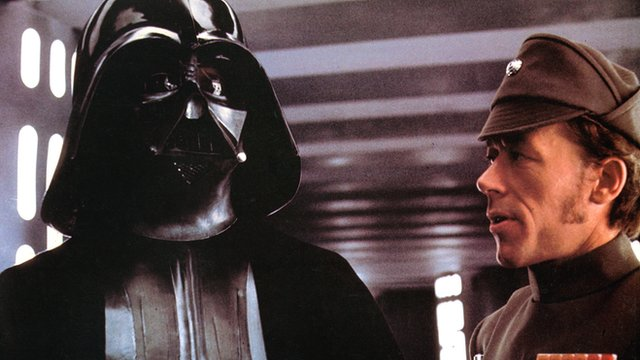 David Prowse as Darth Vader in a scene from the film 'Star Wars', 1977.