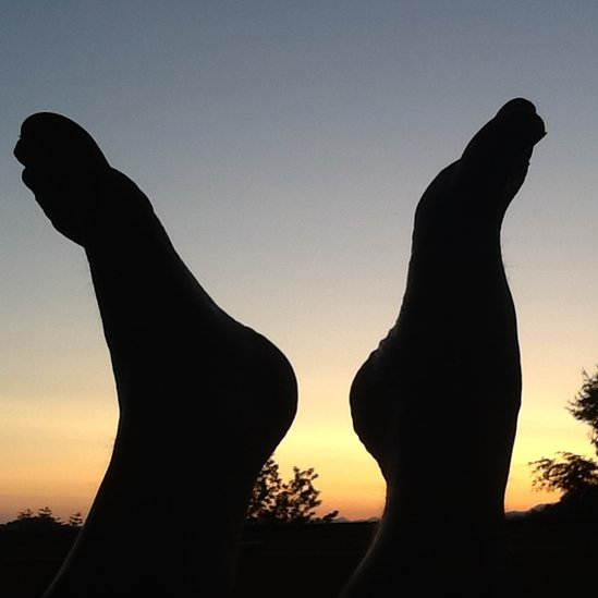 Silhouetted of feet