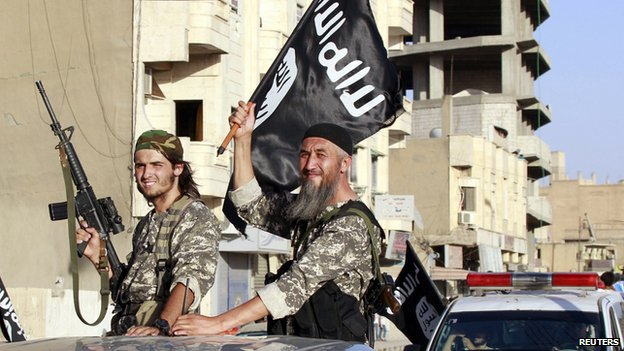 Isis fighters rally in Raqqa