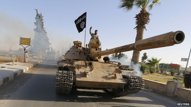 Isis fighter aboard captured tank in Raqqa