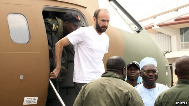 French hostage Georges Vandenbeusch, a French Catholic priest, disembarks from plane in Yaounde on 31 December 2013