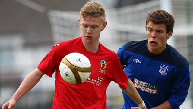 Match action from County Down against County Antrim at the Ballymena Showgrounds