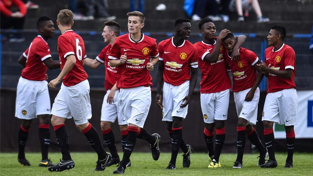 Manchester United celebrate an 11-0 victory over Gold Coast Academy at the Milk Cup