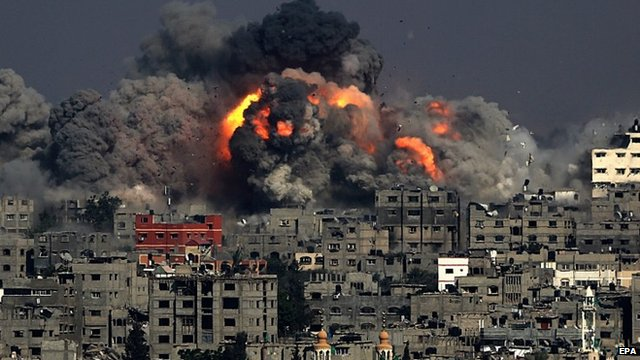 Smoke rises from Tuffah neighbourhood after Israeli air strikes in the east of Gaza City, July 29, 2014