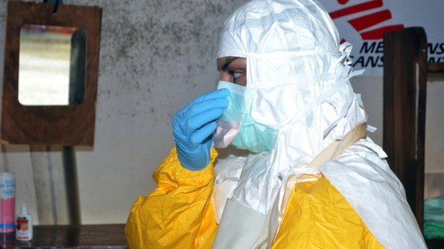 Doctor in protective clothing in Guinea