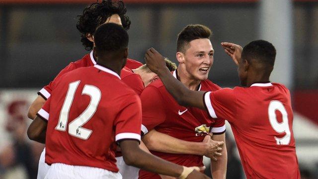 Man Utd's goalscorer Jordan Andrew Thompson celebrates his goal against County Armagh