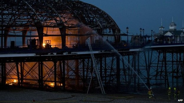 Firefighters remain at Eastbourne Pier fire scene - BBC News