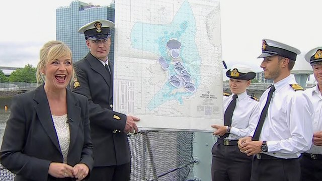 Carol Kirkwood and members of the Royal Navy