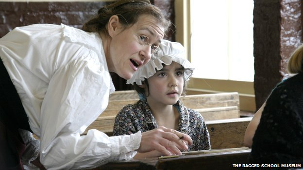 A child learning in a classroom at the Ragged School