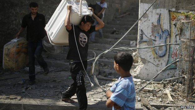 People recover belongings from damaged houses in Gaza - 1 August
