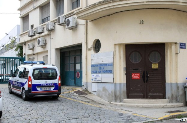 A police car outside a police station in Perpignan, southern France, 2 August