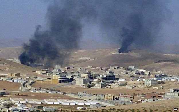 Smoke billows from the Lebanese border town of Arsal, 2 August