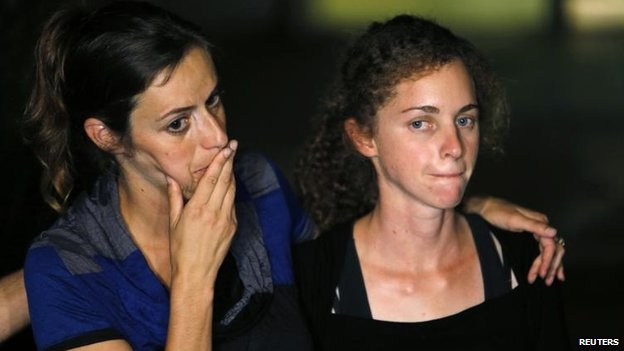 Sister Ayelet and fiancee Edna of Lt Hadar Goldin attend a news conference after his death was confirmed, 2 Aug