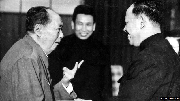 A photo taken in the 1970's outside of Cambodia, shows China's chairman Mao Zedong greeting top Khmer Rouge official Ieng Sary while Khmer Rouge leader Pol Pot looks on
