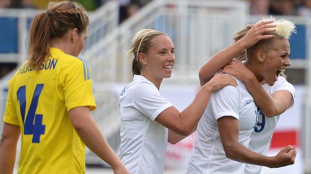 Lianne Sanderson celebrates after scoring for England against Sweden