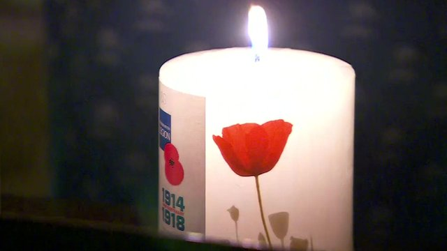 Lit Royal British Legion anniversary candle