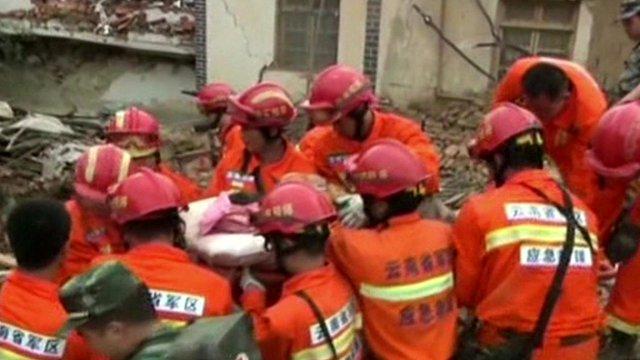 Rescue teams work through rubble