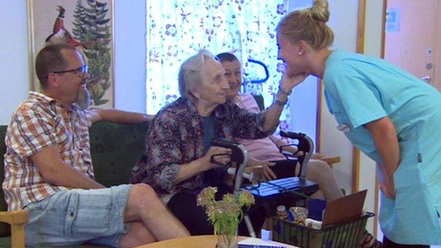 Elderly woman with nurse