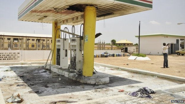 A petrol station is seen after a female suicide bomber blew herself in the city of Kano - 28 July 2014