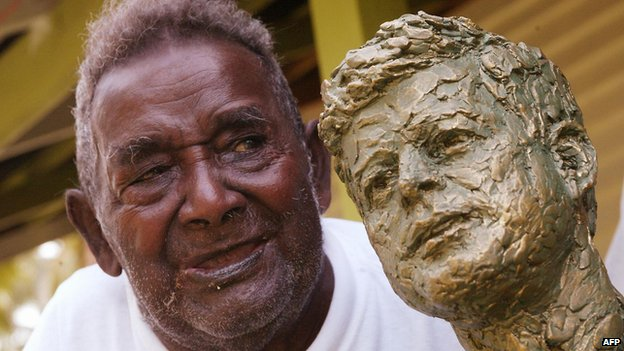 Biuku Gasa in 2003 with the bust of John F. Kennedy presented to him by the Kennedy family