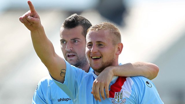 David Cushley celebrates his goal against Warrenpoint Town