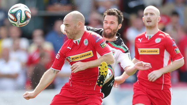 Action from Cliftonville against Glentoran at Solitude