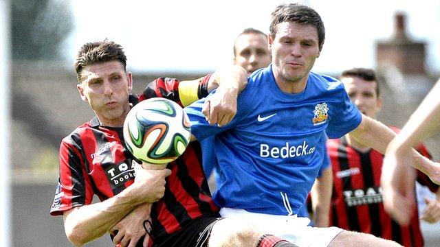 Crusaders Paul Leeman in action against Glenavon's Kevin Braniff