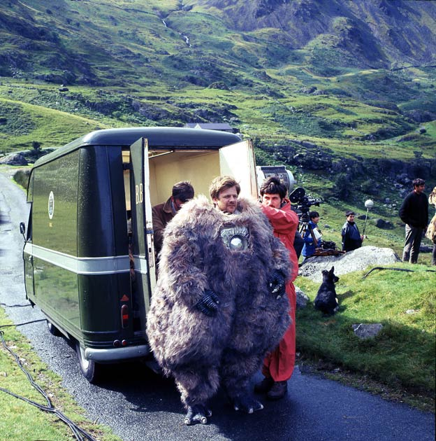 Reg Whitehead wearing the Yeti costume with production staff on location