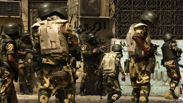Security forces move in on Muslim Brotherhood supporters camped at Rabaa al-Adawia mosque in Cairo - 14 August 2013