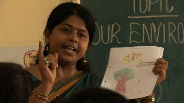 Teacher gives a Sanskrit lesson