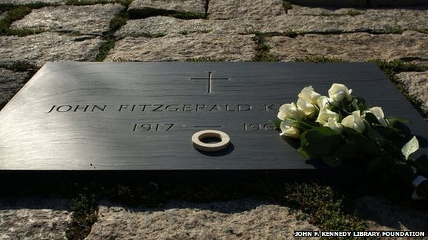 Shell money placed on Kennedy's grave in Arlington