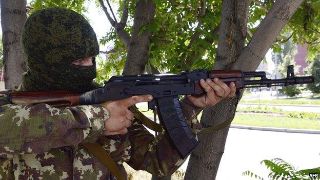 Pro-Russian rebel using Kalashnikov in Donetsk - file pic