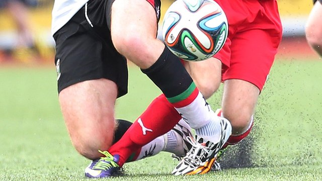 Action from Cliftonville against Glentoran