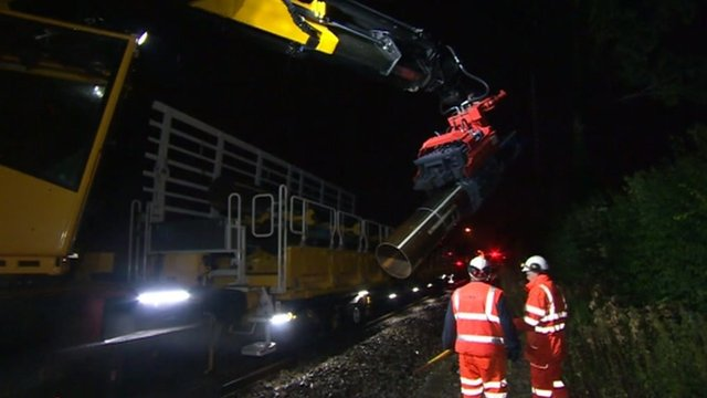 The train works up to five times faster than conventional gangs of track workers