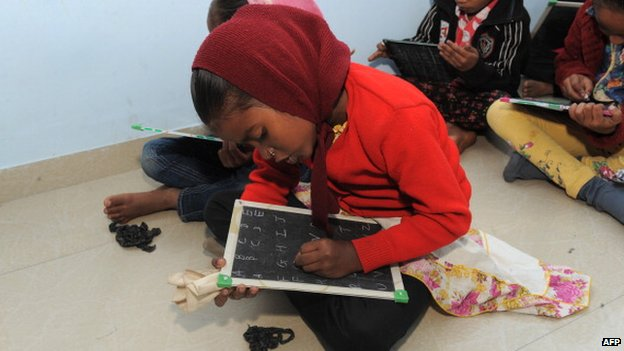 Children learn to write in English in India