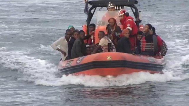 Migrants being brought ashore