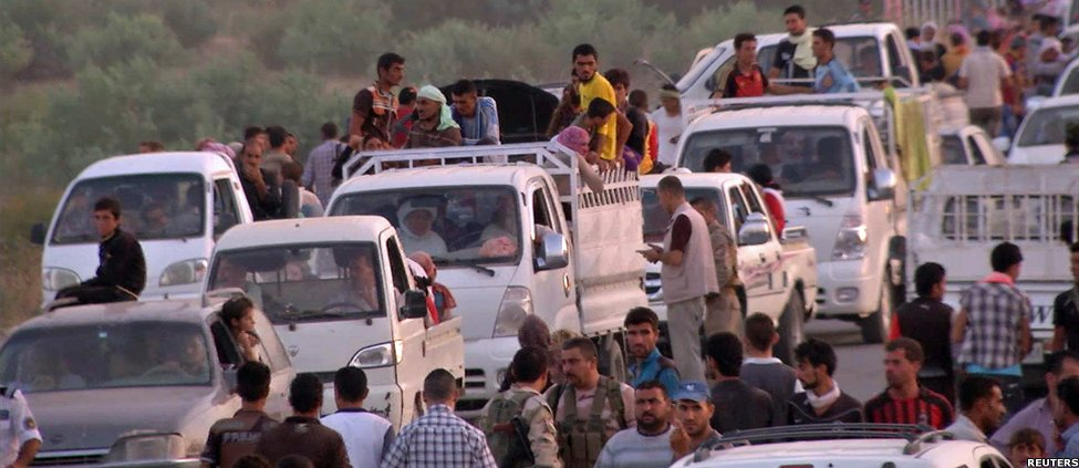 Iraqis people from the Yazidi community arriving in Irbil in northern Iraq after Islamic militants attacked the towns of Sinjar and Zunmar
