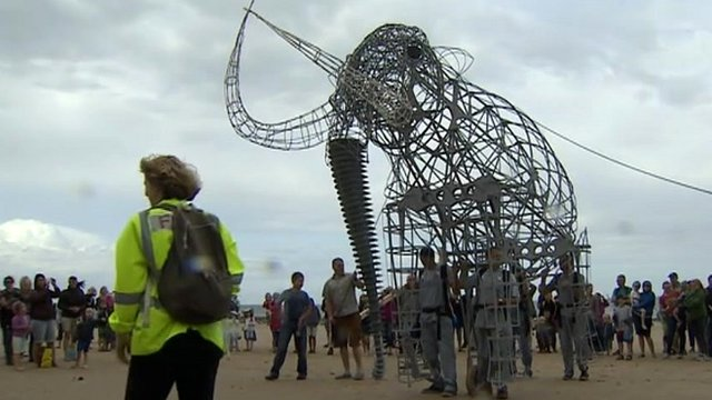 Replica mammoth walking on West Runton beach