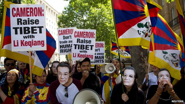 Free Tibet demonstrators protest during a visit by Chinese Premier Li Keqiang to Downing Street in London 17 June 2014